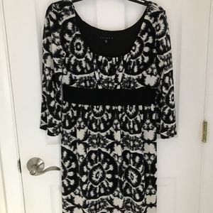 Black and white patterned empire waist dress